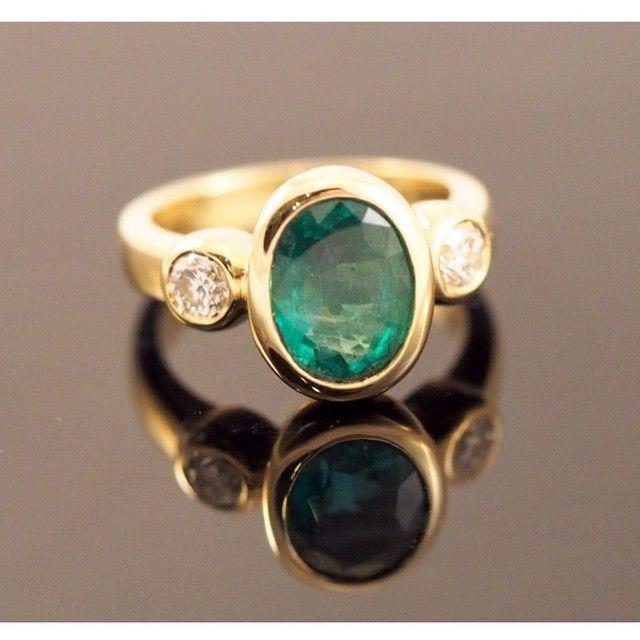 Elegant Katie King designed ring, columbian emerald and diamonds set in 18ct gold.