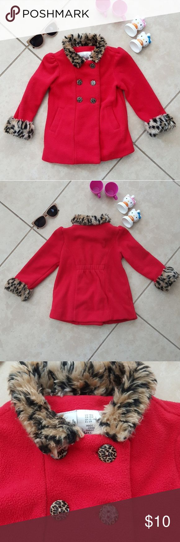 Maggie & Zoe Red Pea Coat Jacket Faux Fur 18M Size 18 months.  Girls Maggie & Zoe Red Jacket Faux Fur.  Show signs of wear.  Color is red (showing slightly brighter in the photos) with animal print faux fur. 100% polyester.  Jacket not lined.  Pockets on each side.  Please see last photo for fabric content and care instructions. Please let me know if you have any questions. Maggie & Zoe Jackets & Coats Pea Coats