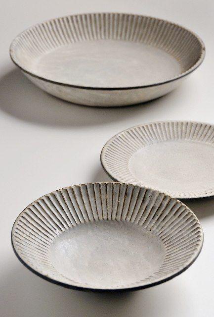 Fabulous plates from Japanese master potter Akio Nukaga at Heath Ceramics. via Remodelista