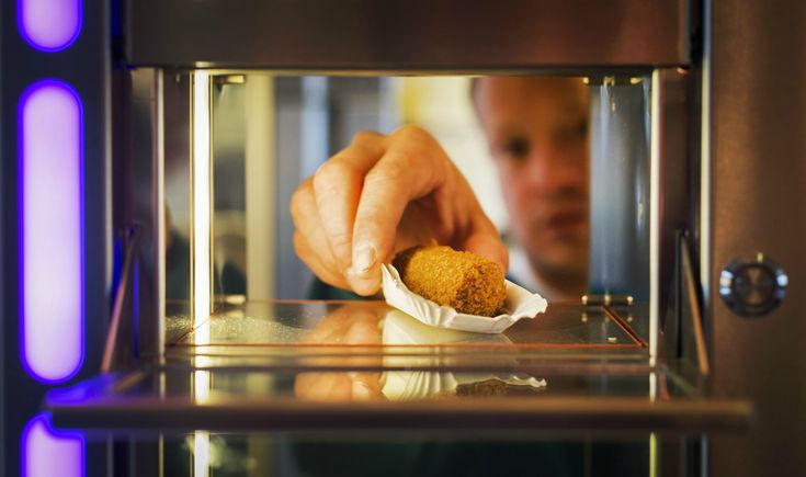 Eating 'out of the wall' is a common Dutch phrase involving grabbing a quick bite from an automated snack bar. A coin is inserted, the lock on the window is released and customers enjoy their favorite snacks on-the-go.