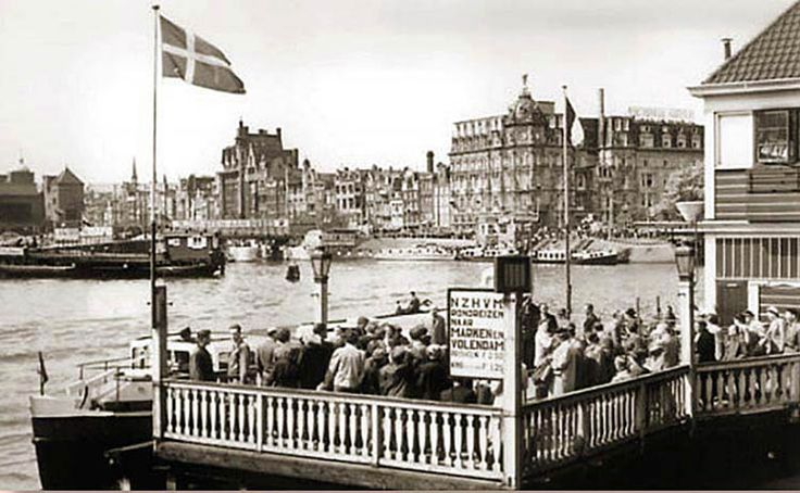 """1956. Arrival and departure dock of """"Bootje van Bergmann"""", a commuter ferry from Amsterdam-Noord to the Open Havenfront, at the NZH-koffiehuis. #amsterdam #1956 #OpenHavenfront"""