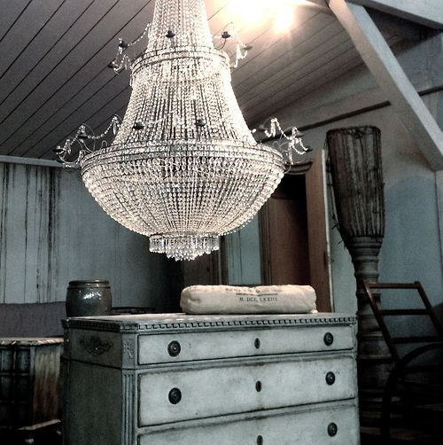 Stunning -- love the juxtaposition between rustic vintage pieces and the bright elegance of the chandelier