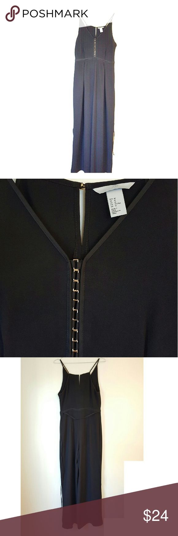 H&M black pant jumpsuit This is a sexy black pant jumpsuit with a matching waist tie and gold details down the chest. Its a size 10 in great condition. Wear this with a pair of sexy heels on a night on the town. H&M Pants Jumpsuits & Rompers