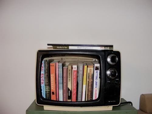 An old TV as a bookshelf. How cool.