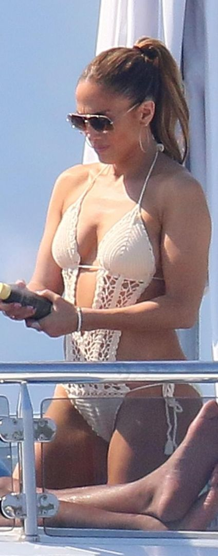 Who made Jennifer Lopez's sunglasses and crochet swimwear?