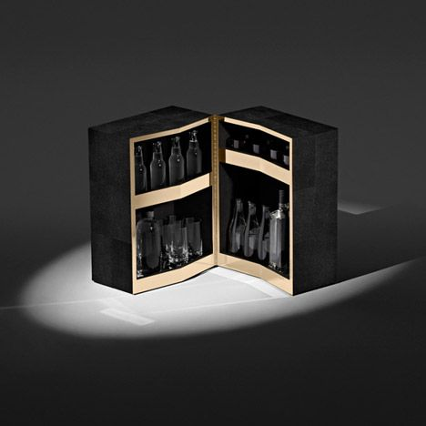 alexander wang bar cabinet wrapped in squares of jetblack shagreen that opens to reveal jagged brass shelves
