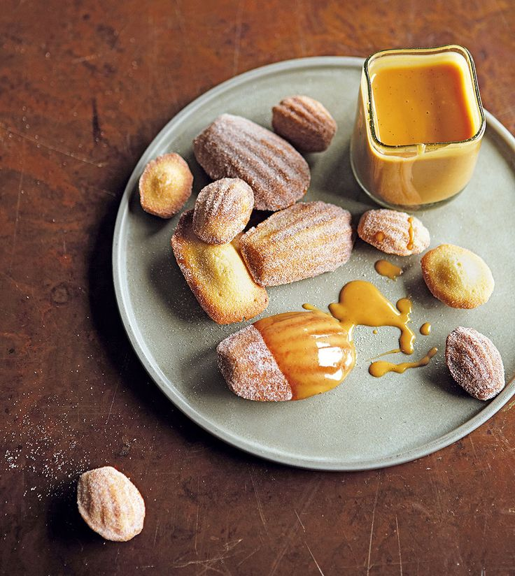 James Martin's classic French madeleine recipe is light-as-a-feather. Served with the spiced caramel sauce, they work wonderfully as a dinner party dessert.