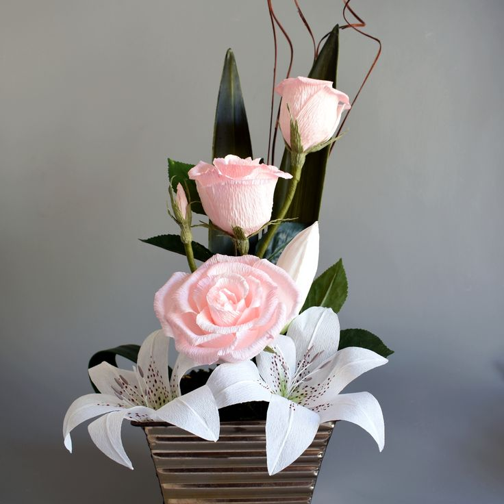 Rose and Lilly arrangement made from crepe paper flowers and artificial leaves. The Flower and Craft Boutique.