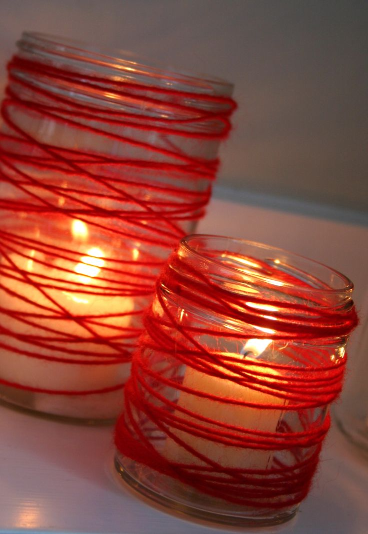 valentine's day, this is so simple & cute. Just use old pasta sauce jars that you've cleaned and wrap red yarn around the jar, put a candle in it and BAM! Valentine's decor.
