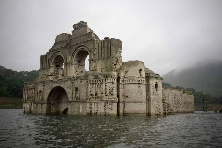 The remains of a mid-16th century church known as the Temple of Santiago, as well as the Temple of Quechula, is visible from the surface of the Grijalva River, which feeds the Nezahualcoyotl reservoir, due to the lack of rain near the town of Nueva Quechula, in Chiapas state, Mexico, Friday, Oct. 16, 2015.   Photo: David Von Blohn, STR / AP