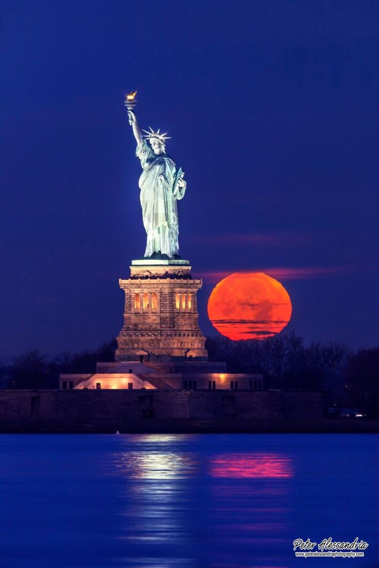Another view of the full moon setting behind the Statue of Liberty by peteralessandriaphotography