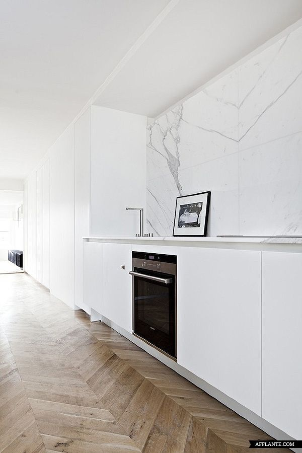 Beautiful white marble wall inside the Frederic Berthier designed kitchen..