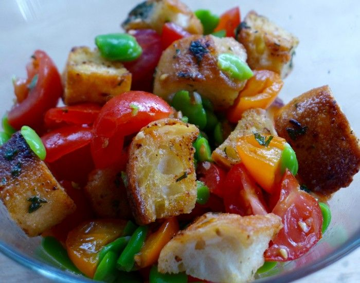 a salad of broad beans, tomatoes and garlic croutons #vegan