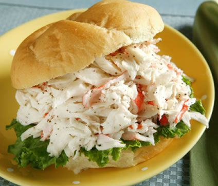 This delicious crab salad sandwich will have you forget you are eating imitation crab. The flaky seafood is covered with a light dressing and stuffed into a soft roll. You will not believe how good this imitation crab salad recipe is! This is a perfect sandwich to share with your family or a close friend. It has the perfect balance between seafood and bread, letting the seafood shine with all its sweetness.