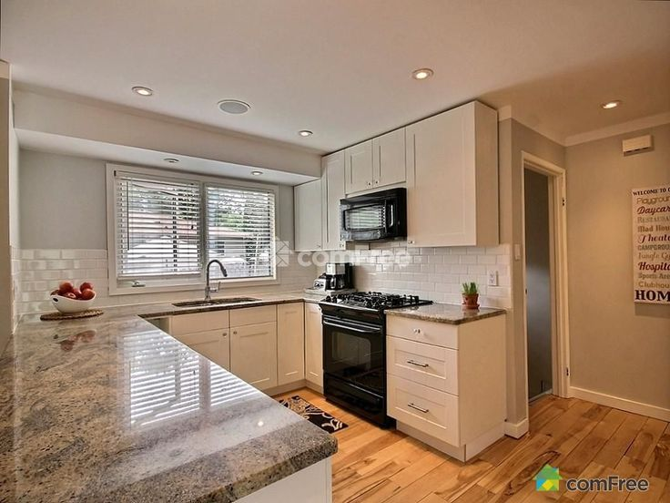 Ikea Adel cabinets with Kashmir White granite