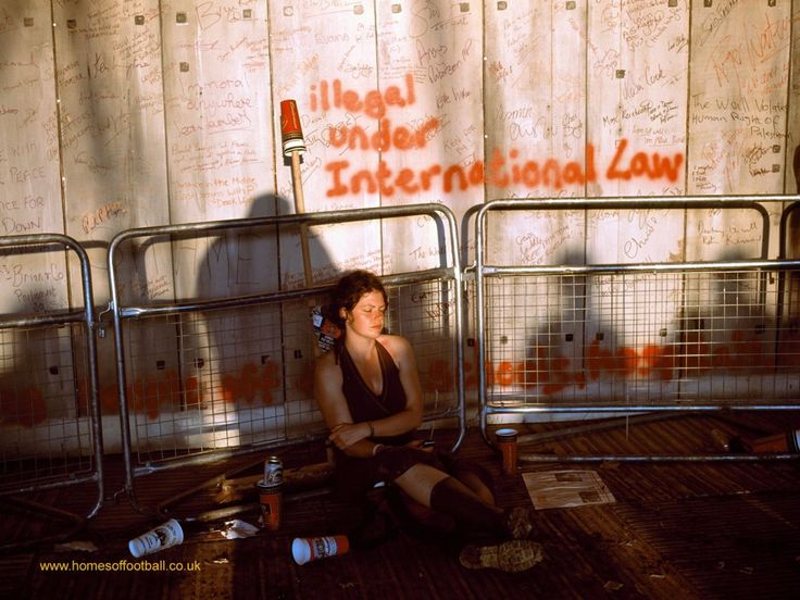Woman dozing under international law, Glastonbury Festival,England year2005 by Stuart Roy Clarke