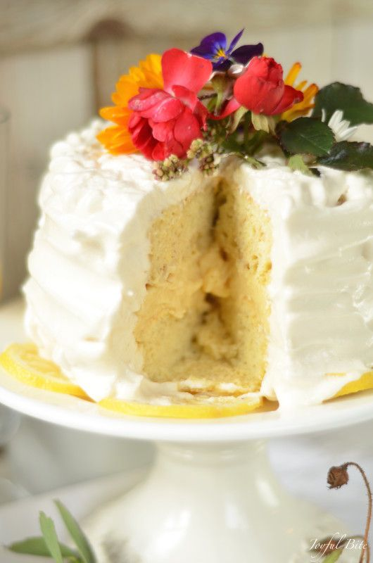 Paleo Lemon Cake with Lemon Curd and Meringue Frosting - this delicious cake recipe is a guest post from Kaylie of Joyful Bite!