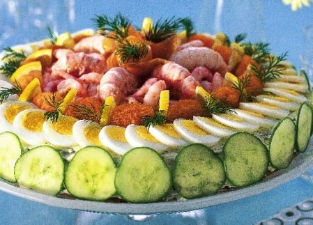 How To Make A Smörgåstårta or a Swedish Sandwich.  There is bread, mayo, and other sandwich ingredients inside and it looks spectacular!