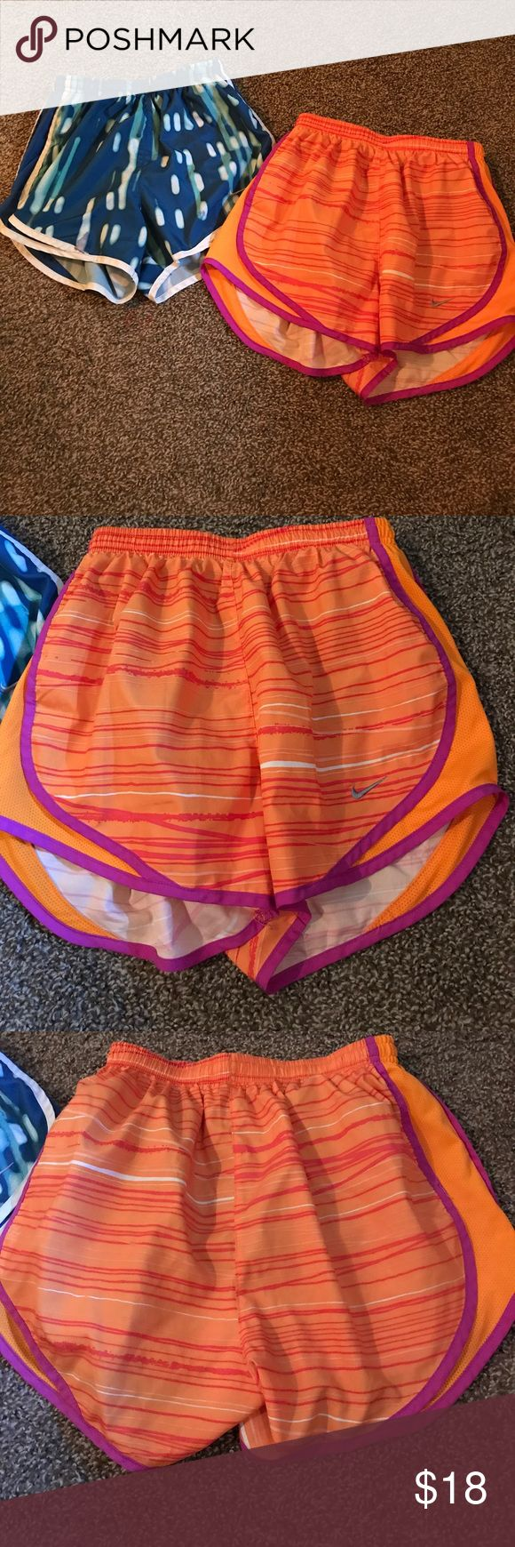Nike XS Dri fit shorts extra small orange blue Nike XS shorts for sale! One is orange with purple accents with the panty liner. The other is blue, Aqua and white with the panty liner. The orange shorts are in excellent condition, and the blue shorts have a small stain on the front, and the tag is a bit worn. Make me an offer or bundle with my other items to save! Nike Shorts