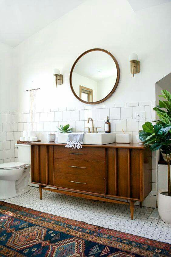 Repurposing a piece of furniture for a vanity sink top is a great idea! I love this mid century piece used in this bathroom!