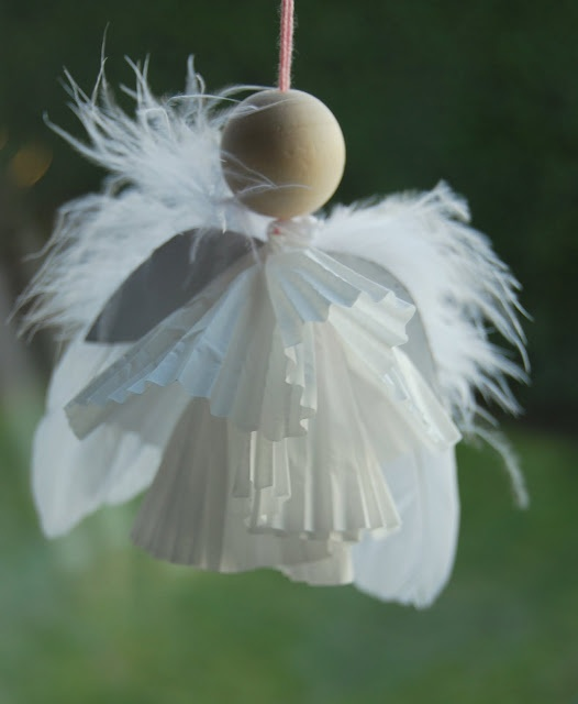 Using a wooden bead and cupcake liners, it's a beautiful angel.  (Translate the blog for directions)