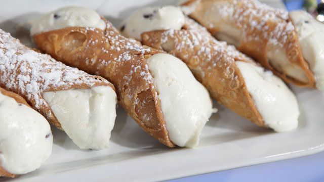 Cannolis - Buddy Valastro's recipe Cream: -½ pound impastata cheese -¼ pound ricotta cheese -2 ounces sugar -1 drop cinnamon oil -1 ounce cocoa drops -Cannoli shells -Cooking Directions: Combine impastata, ricotta, sugar, and cinnamon oil in mixer with paddle attachment. Once combined, add cocoa drops. Pipe filling into cannoli shells. Recipes courtesy Buddy Valastro.