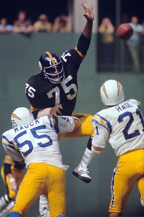 "Pittsburgh Steelers DT ""Mean Joe"" Greene leaps to block a pass by San Diego Chargers QB John Hadl on Oct. 3, 1971. The 1969 NFL Rookie of the Year, 1972 and '74 Defensive Player of the Year, Greene..."