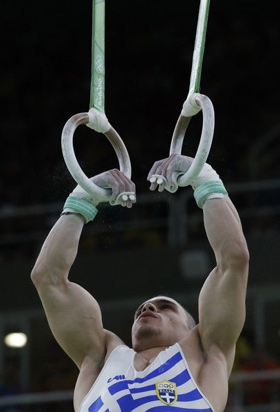 Greece's Eleftherios Petrounias competes in the men's rings event final of the Artistic Gymnastics at the Olympic Arena during the Rio 2016 Olympic Games in Rio de Janeiro on August 15, 2016. / AFP / Thomas COEX