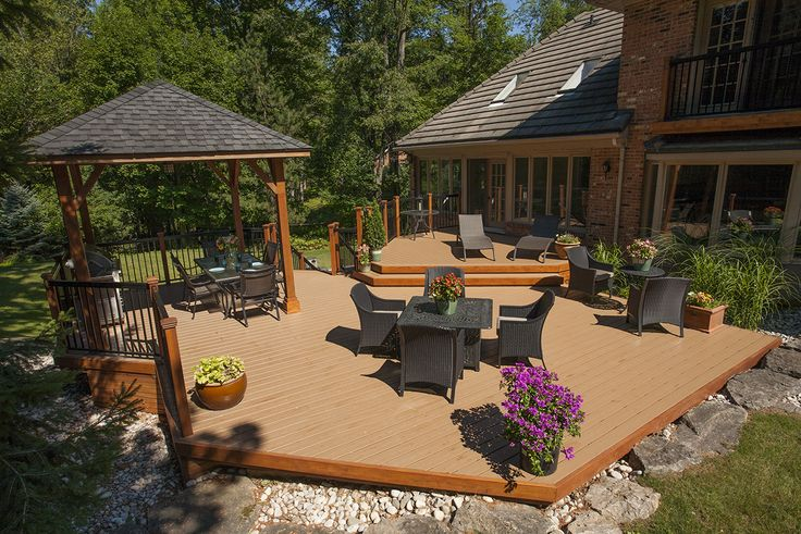A large deck and gazebo built in Ancaster Ontario using Armadillo decking and cedar.