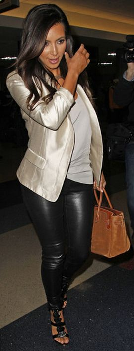 Who made  Kim Kardashian's black sandals, brown suede handbag, and gold blazer that she wore at LAX airport?