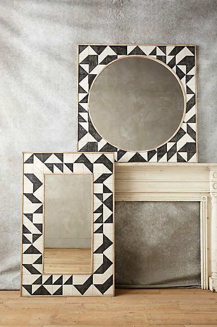 Anthropologie EU Brick Mosaic Mirror. We adore the intricate, geometric motif of this carved oak mirror. At once modern and rustic, a style to elegantly enliven bare walls.