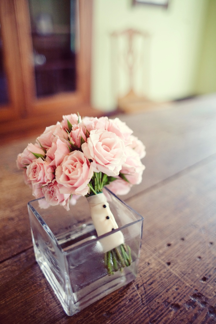 The bridesmaids and junior bridesmaid will carry small bouquets of pale pink spray roses wrapped in ivory linen with the stems showing.