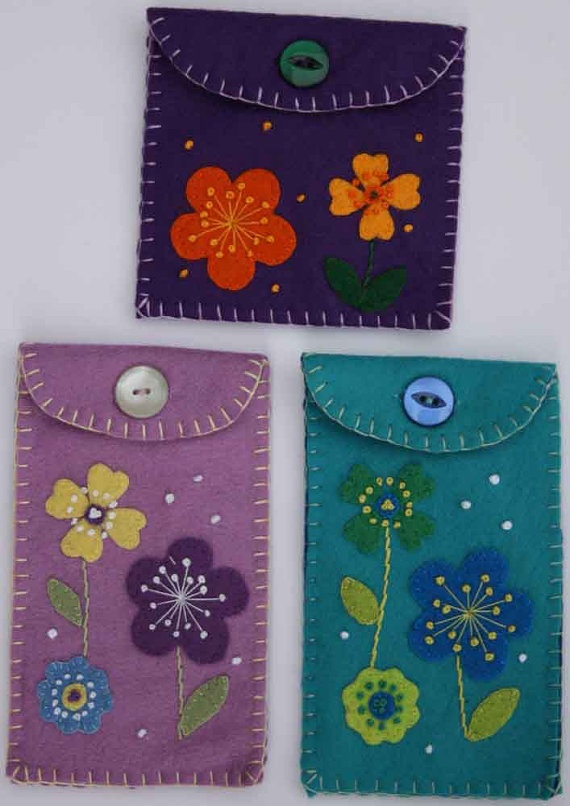 Felt flower purse with button. Purple coin pouch. $ 17.00, via Etsy.