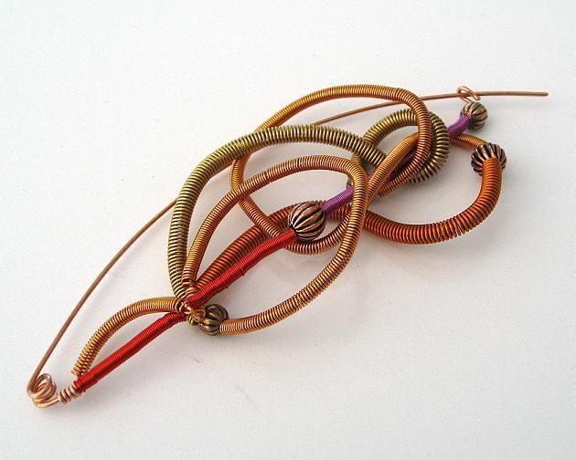 Kopparbrosch ca 11 cm lång. Copper brooch, length 11 cm.