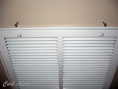 Repurposed Door Mat to Cover an Ugly Return Air Vent