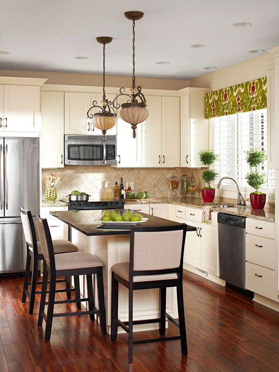 Using a tried and true palette, this kitchen is familiar and beautiful. Crisp white cabinetry, granite countertops, and tile backsplash in a traditional pattern create a smart space.