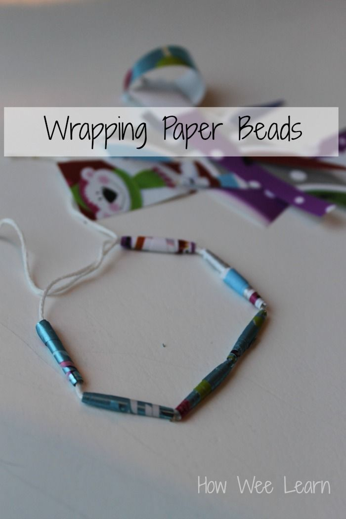 Reusing wrapping paper to make beads. Awesome craft for kids and great for fine motor skills too.