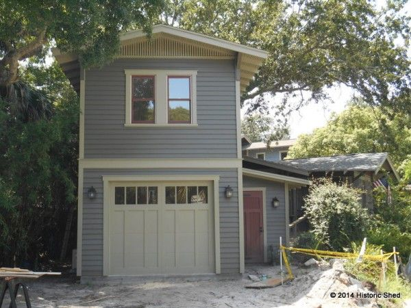 A steel overhead garage door with a carriage house overlay by CHI finishes out the front facade.