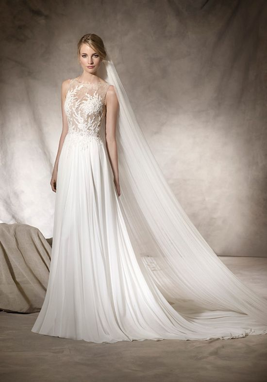 Sophisticated flare wedding dress in gauze with beautiful bateau neckline in Chantilly, lace, guipure and gemstone embroidery, creating an incredible second skin effect. The Knot provides price estimates to give you a general idea of the cost of a dress. Please visit retailers in your area for exact pricing. Prices will vary by region.
