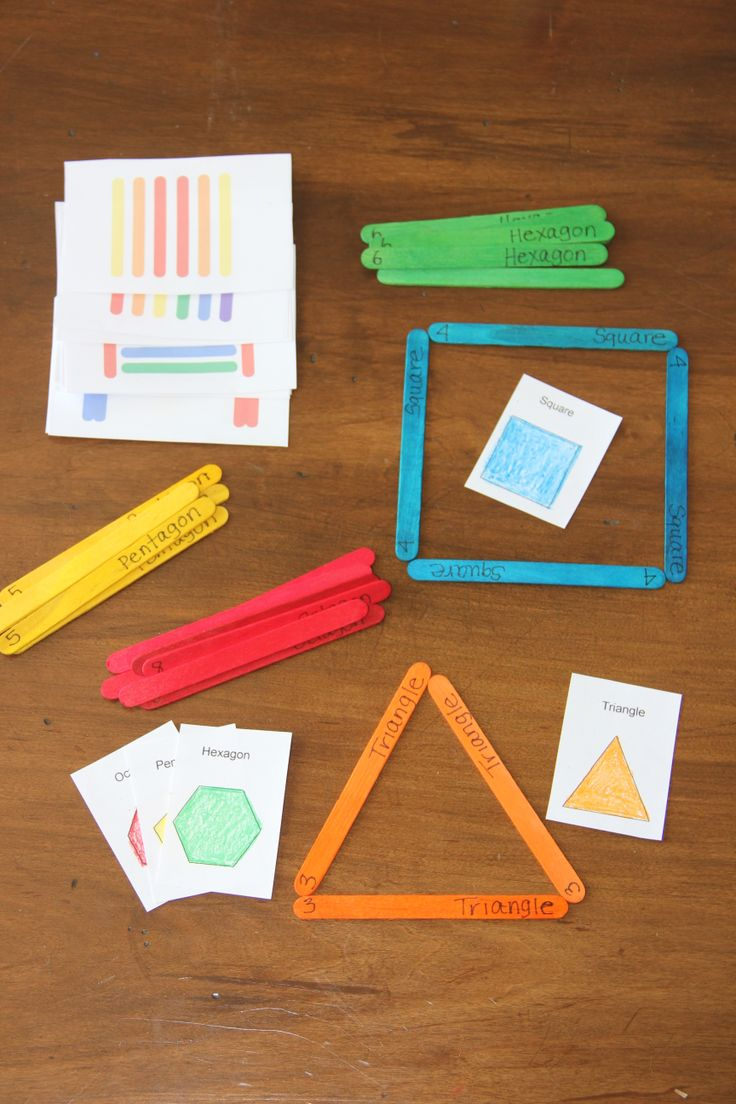 Colored popsicle sticks to practice forming shapes and cards to replicate patterns!