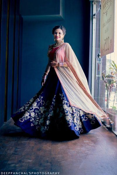 light pink bluse, cream flared dupatta, indigo lehenga, silver floral motifs…