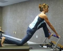 pilates reformer hip stretching exercise