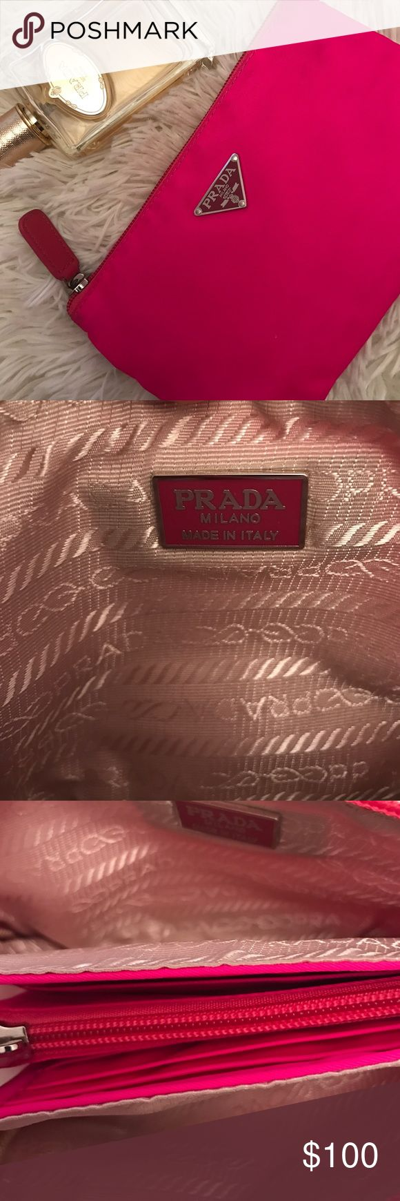 Prada Clutch Wallet Has two openings for money and card holders in the middle and coin purse as seen in photos! Some spots of dirt on the edges from use but overall good condition. The price is due to the slightly dirty edges to be fair. Prada Bags Wallets