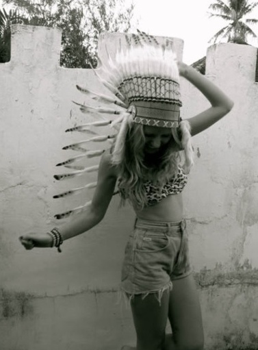 """bohemian native american headdress"" was its original caption.  NO.  Native American Regalia is sacred and must be earned--a culture symbol that is MORE than just a costume or part of a ""hipster/bohemian"" lifestyle for people who know nothing about it."