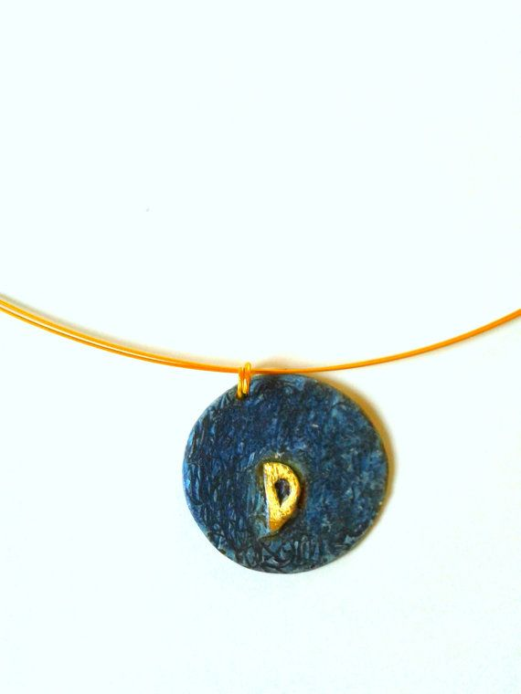 Handmade personalized alpaca and brass pendant with blue patina