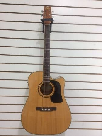 Washburn Acoustic Guitar National 2007 priced at $179.99 available at Gadgets and Gold in Gainesville, Fl