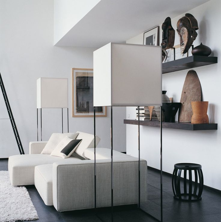 Cultural art offset by minimal furnishings // Contemporary Home Style by B+B Italia