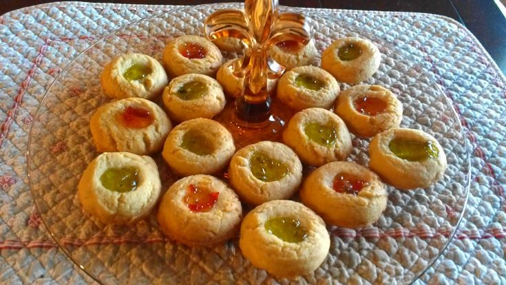 Cornmeal Thumbprints with pepper jelly! I can not make enough of these cookies this year I used pomegranate pepper jelly for the red and mint pepper jelly for the green!