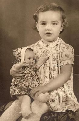 Vintage photo of a little Girl with her doll circa 1930 - 1940.
