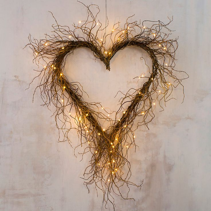 "Wild and wonderful, this heart-shaped wreath is formed by an abundance of curly willow twigs. Beautiful when displayed alone, it also welcomes glowing lights and seasonal adornments.- Curly willow, metal base, floral wire- Indoor use only- USA20""W, 27""L, 1.5""D"